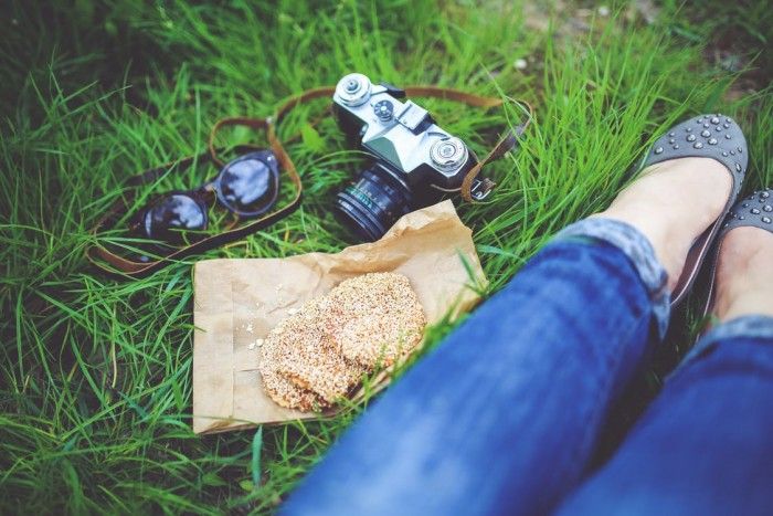 food-woman-camera-girl snacking when traveling instagram